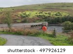 Small photo of Rural Lane Leading to Meldon Reservoir and Dam with a Life Buoy in the Foreground within Dartmoor National Park in Devon, England, UK