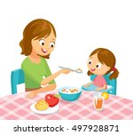mother feeding baby girl | Shutterstock .eps vector #497928871