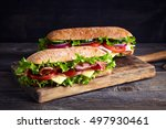 two fresh submarine sandwiches... | Shutterstock . vector #497930461