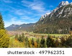 the small village at the foot... | Shutterstock . vector #497962351