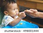 9 months asian baby drinking... | Shutterstock . vector #498001444