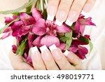 hands with long artificial... | Shutterstock . vector #498019771