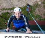 man climbing up a wall ... | Shutterstock . vector #498082111