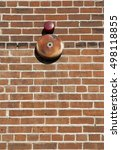 Small photo of Textured brick wall background and alarm bell.
