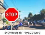 stop sign by the city road | Shutterstock . vector #498224299