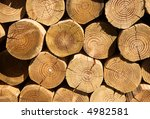 Close up of a stack of cut logs. - stock photo