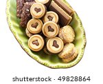 chocolate biscuits in green tray - stock photo