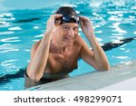 Smiling Old Man In A Swimming...