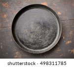 Old Cast Iron Frying Pan On Th...