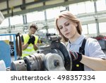 mature female worker working on ... | Shutterstock . vector #498357334