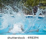 This is a stop action shot of a big splash in a pool. - stock photo