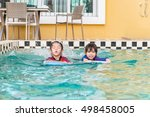 two little girls swimming in... | Shutterstock . vector #498458005
