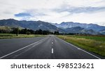an empty highway with mountains ... | Shutterstock . vector #498523621