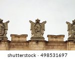 Small photo of Fragment of parapet administrative government building with USSR symbols. Hammer and sickle. Typical pattern of Stalinist architecture.