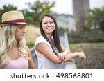 two nice beautiful young women... | Shutterstock . vector #498568801