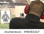 shooting with a pistol. man... | Shutterstock . vector #498583267