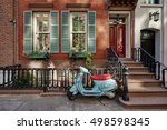 A Brownstone Building With A...