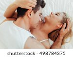couple sensual foreplay in bed... | Shutterstock . vector #498784375
