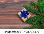 christmas tree branch gifts on... | Shutterstock . vector #498784579