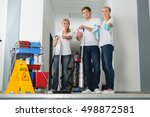 group of happy young janitor... | Shutterstock . vector #498872581