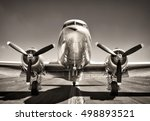 Stock photo vintage airplane on a runway 498893521