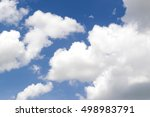 soft white clouds against blue... | Shutterstock . vector #498983791