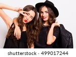 two pretty stylish girls have... | Shutterstock . vector #499017244