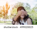 man covering eyes to young... | Shutterstock . vector #499020025