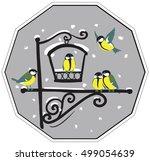 birds at feeders  in winter | Shutterstock .eps vector #499054639
