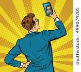retro man selfie on smartphone...   Shutterstock .eps vector #499074205