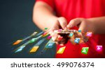 man holding smartphone with... | Shutterstock . vector #499076374