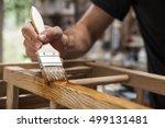 hand holding a brush applying... | Shutterstock . vector #499131481