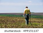 Man With Metal Detector In A...