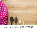 Small photo of hankie and spoon on wood backgrounds. top view