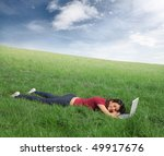 woman resting on a green meadow