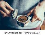 barista presses ground coffee... | Shutterstock . vector #499198114