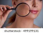 woman holding magnifier and...   Shutterstock . vector #499199131