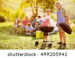 happy family grilling meat on a ... | Shutterstock . vector #499205941