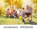 happy family grilling meat on a ... | Shutterstock . vector #499206181