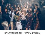 Stock photo party fun group of beautiful young people throwing colorful confetti and looking happy 499219087