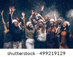 celebrating new year together.... | Shutterstock . vector #499219129