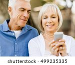happy senior couple looking at... | Shutterstock . vector #499235335