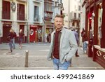 handsome middle aged man posing ... | Shutterstock . vector #499241869