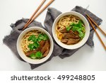 noodles and beef in two bowls ... | Shutterstock . vector #499248805