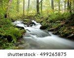 forest stream on a misty autumn ... | Shutterstock . vector #499265875