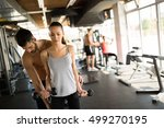 personal trainer helping woman... | Shutterstock . vector #499270195