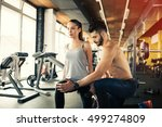 personal trainer giving... | Shutterstock . vector #499274809
