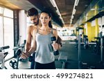 personal trainer giving... | Shutterstock . vector #499274821