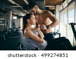 personal trainer giving... | Shutterstock . vector #499274851