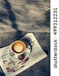 Small photo of Coffee Americano Espresso Newspaper Couch Concept